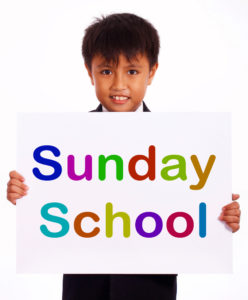 Sunday-School-kid-with-sign
